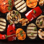Background of grilled vegetables on a grill macro. horizontal view from above