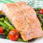Fillet of red fish salmon with green beans, tomatoes and black olives, tasty diet dinner