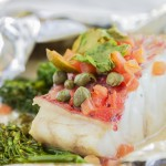 Hawaiian pink snapper cooked in a white wine butter sauce with broccolini, and spices